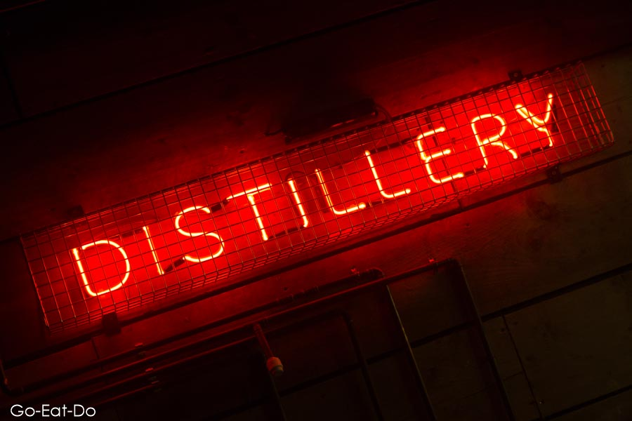 Neon distillery sign at Poetic License in Sunderland.