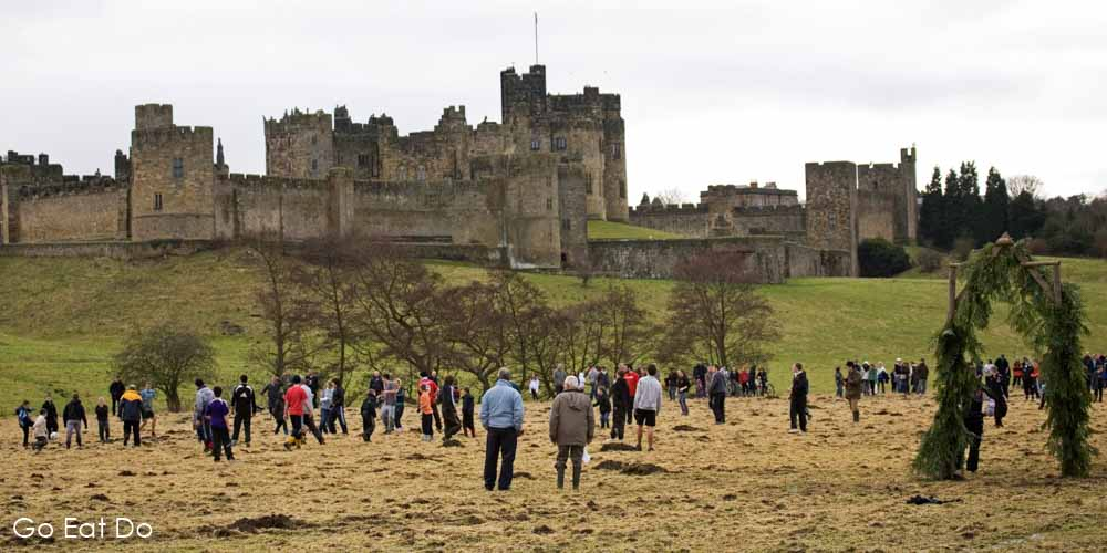 Traditional Shrovetide Tuesday football match between residents of the St Paul's and St Michael's parishes by Alnwick Castle in Northumberland.