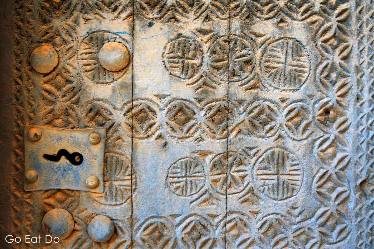 Detail of a traditional carved door in the village of Al Hamra, Oman