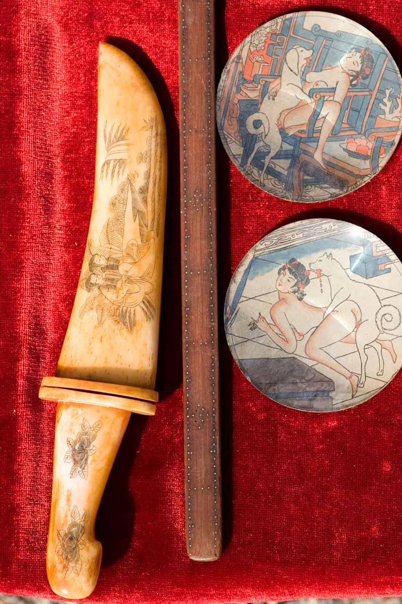 A knife among antiques on sale at the Kobo-san flea market at the Toji Temple in Kyoto, Japan