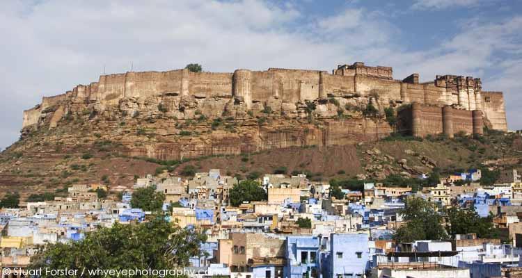 Hilltop Meherangarh Fort, a historic fortress, overlooks houses in Jodhpur, Rajasthan, India