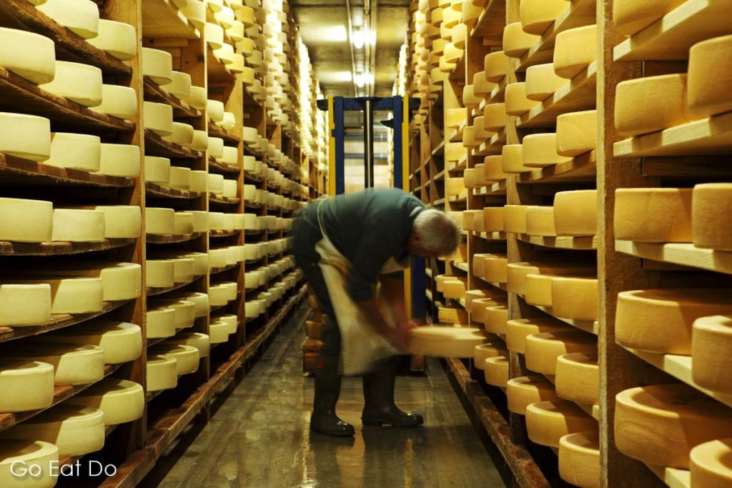 Wheels of Swiss mountain cheese being seasoned and turned at La Maison de L'Etivaz in Etivaz, Switzerland.