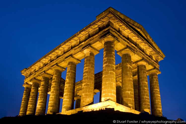 Penshaw Monument illuminated at night on Penshaw Hill in Sunderland, England