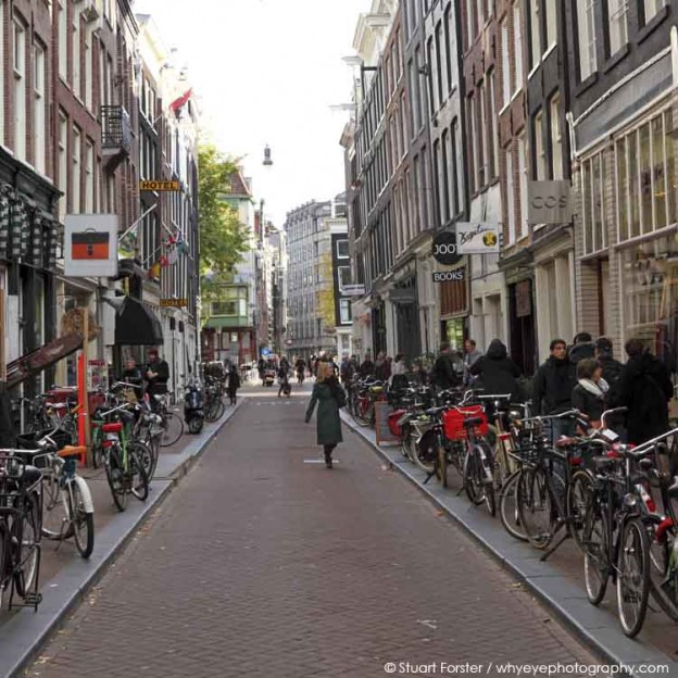Shoppers and bicycles on Ree Straat in the Negen Straatjes (Nine Streets) in central Amsterdam, the Netherlands.