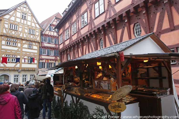 A Christmas market stall in front of half-timbered town houses in Esslingen am Neckar, Germany