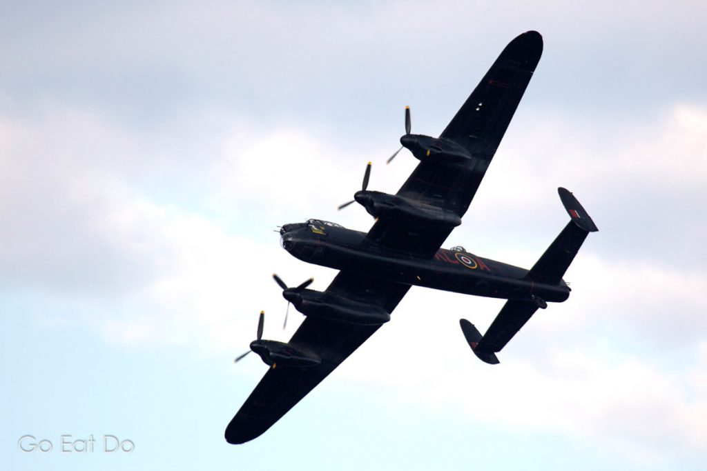 A Lancaster bomber flying as part of the RAF's Battle of Britain Memorial Flight.