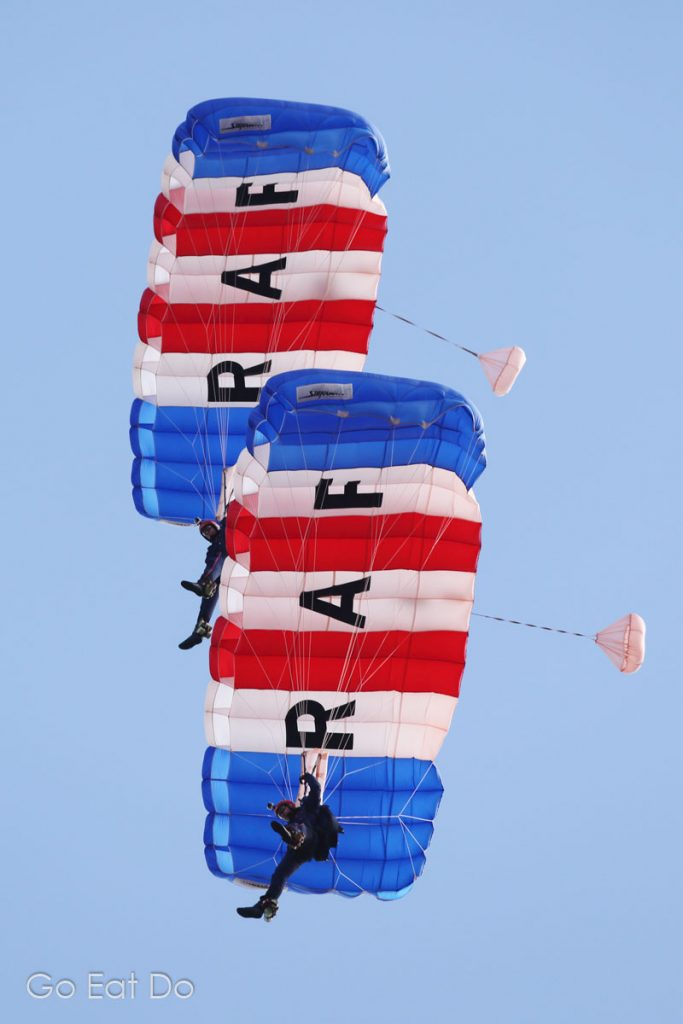 Members of the Raoyal Air Force's Falcons Parachute Display Team performing on a sunny day at Sunderland International Airshow.