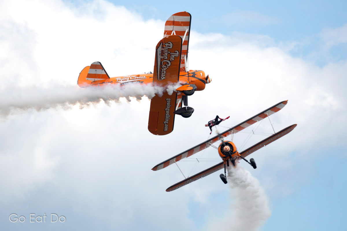 Biplanes flying during a wing walking display at Sunderland International Airshow in North East England.