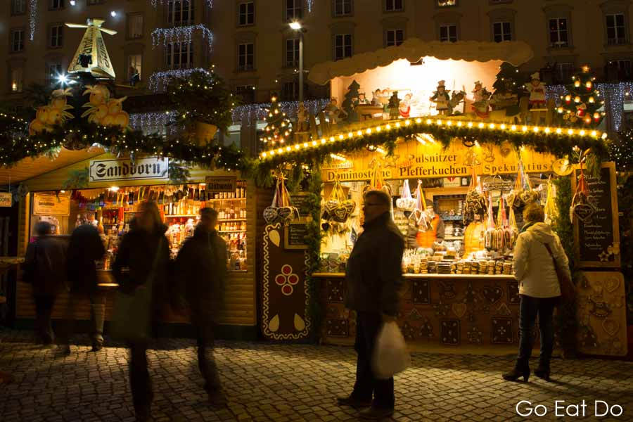 Traditional stalls at night at the Striezelmarkt, in Dresden, Germany's oldest Christmas market