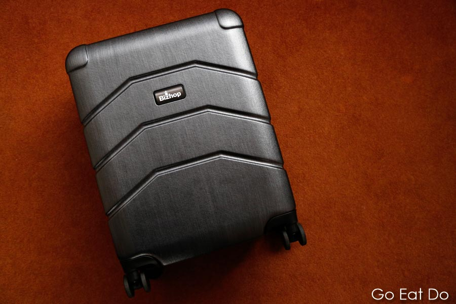 A hard-shell Bizhop suitcase designed as carry on luggage for business travel