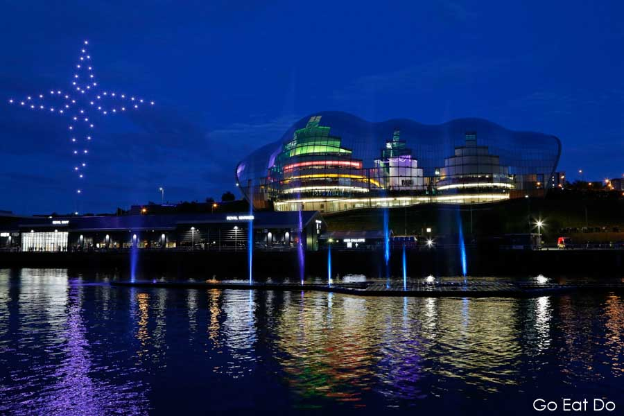 Drones in North Star shape at night above the River Tyne, Sage Gateshead and Get North Water Sculpture at Great Exhibition of the North opening ceremony in NewcastleGateshead