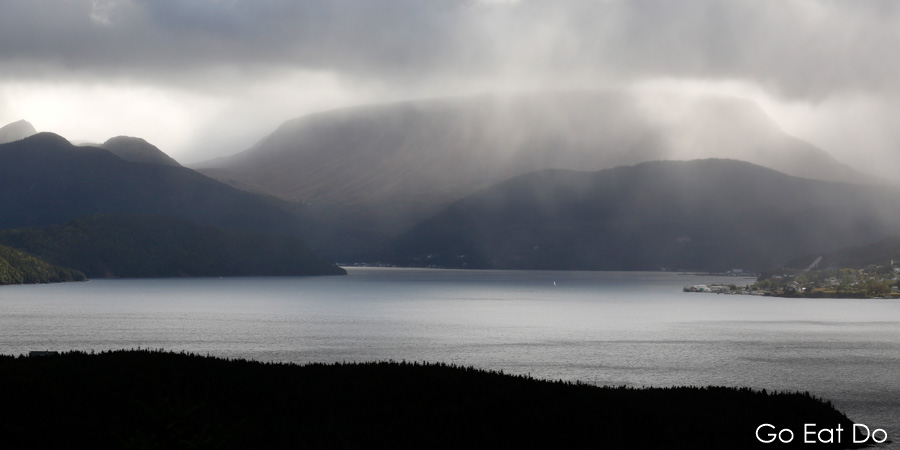 A harbour in a storm? Sunbeams burst through clouds over Bonne Bay in western Newfoundland.