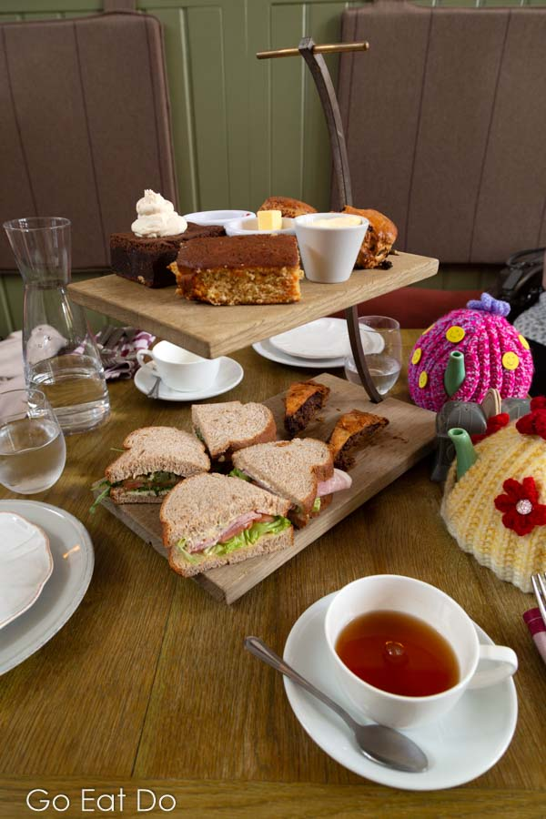 Rustic afternoon tea at St Mary's Inn, served on a two-tier wooden cake stand