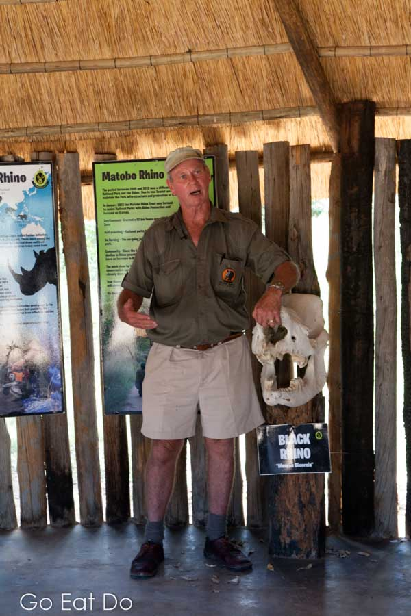 Guide Norman Bourne by the skull of a black rhino killed by poachers for its horn in Matobo National Park, Zimbabwe