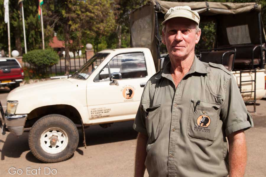 Norman Bourne, the owner of BlackRhino Safaris, by one of his trucks in Bulawayo, Zimbabwer