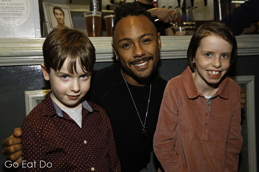 Young fans meet Marcus Collins, who plays the Genie in Aladdin.