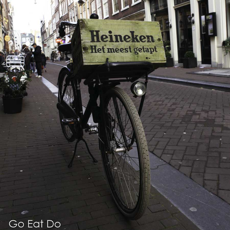 Bicycle with a Heineken crate on it in the Negen Straatjes (Nine Streets) in central Amsterdam