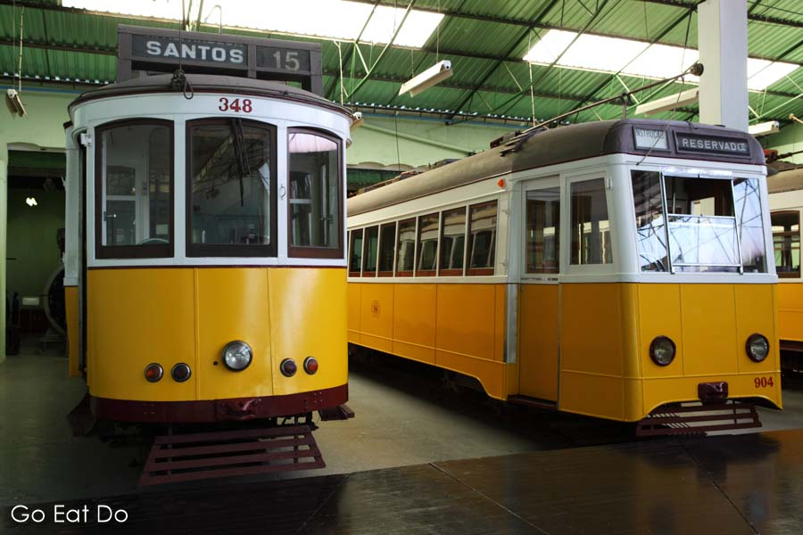 Historic trams displayed at the Museu da Carris transport museum in the Alcantara district of Lisbon, Portugal