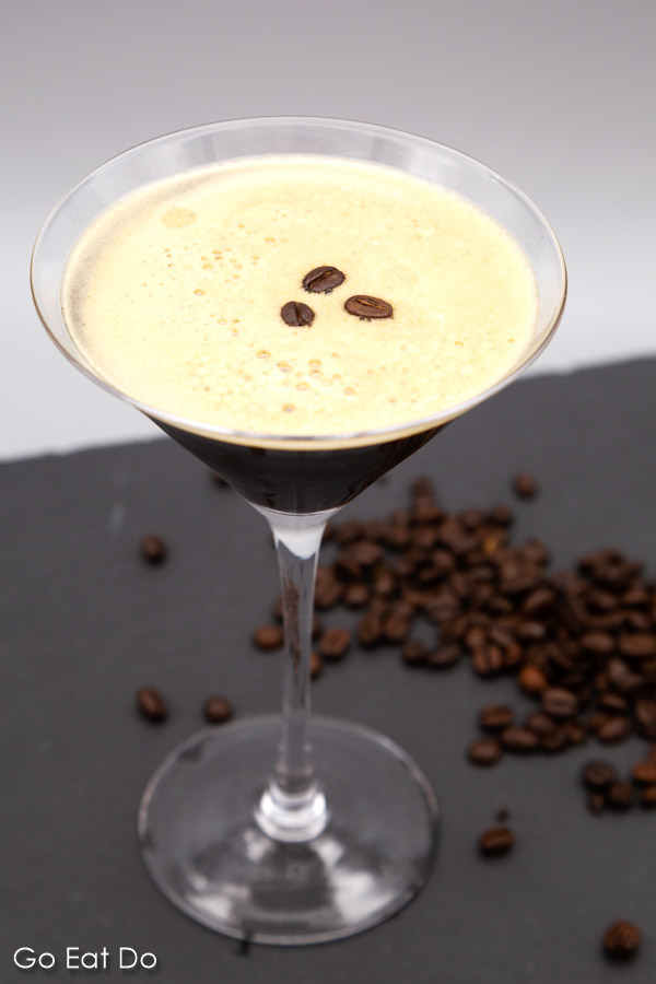 Espresso martini served in a martini glass and garnished with roast coffee beans