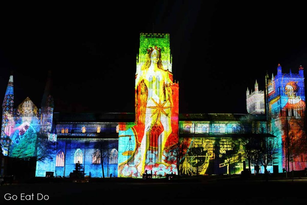 Historic imagery features in The World Machine, projected onto the facade of Durham Cathedral during the Lumiere Durham festival of light