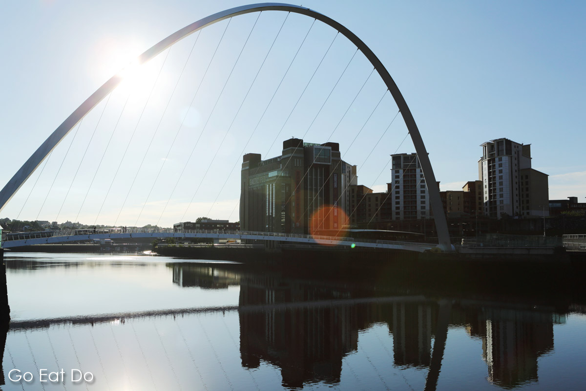 Sunshine over Gateshead Millennium Bridge and Baltic Centre for Contemporary Art seen from the Newcastle Quayside