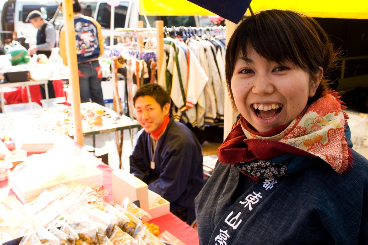 A welcoming stall holder at the Kobosan market in Kyoto, Japan