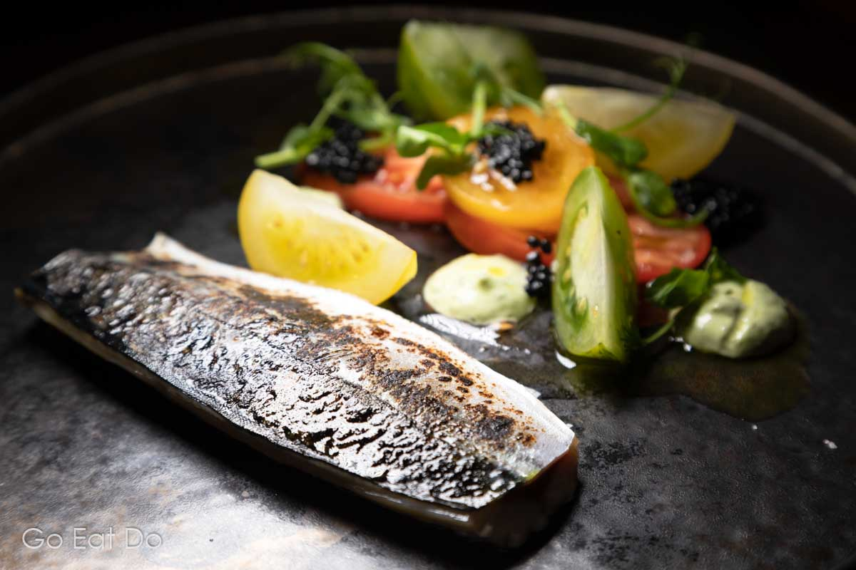 Cured and torched mackerel with caviar served with a salad featuring tomato and basil at the Knights Restaurant
