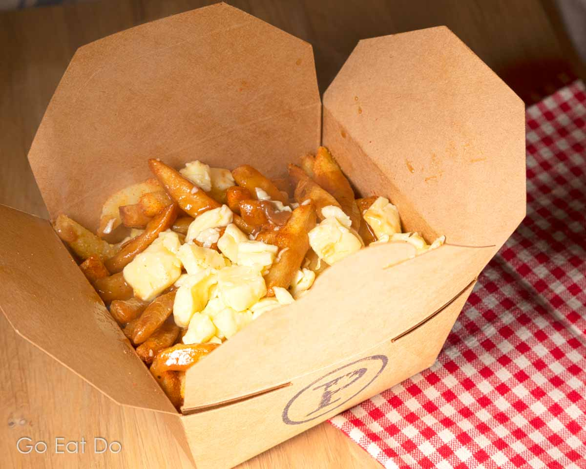 Curds and gravy on chips, the holy trinity of ingredients that are served as poutine