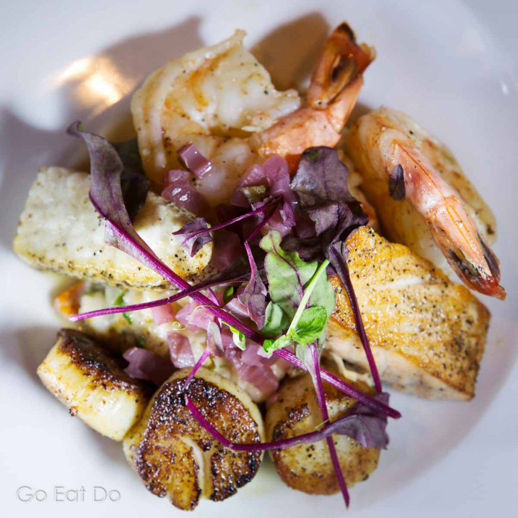 Digby scallops, king prawns and fish served served with risotto at the Five Fishermen Restaurant in Halifax.