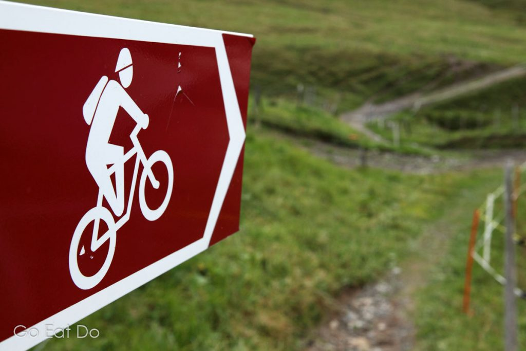 A mountain cycling trail runs through the village of Taveyanne, Switzerland. The area is within a nature reserve.