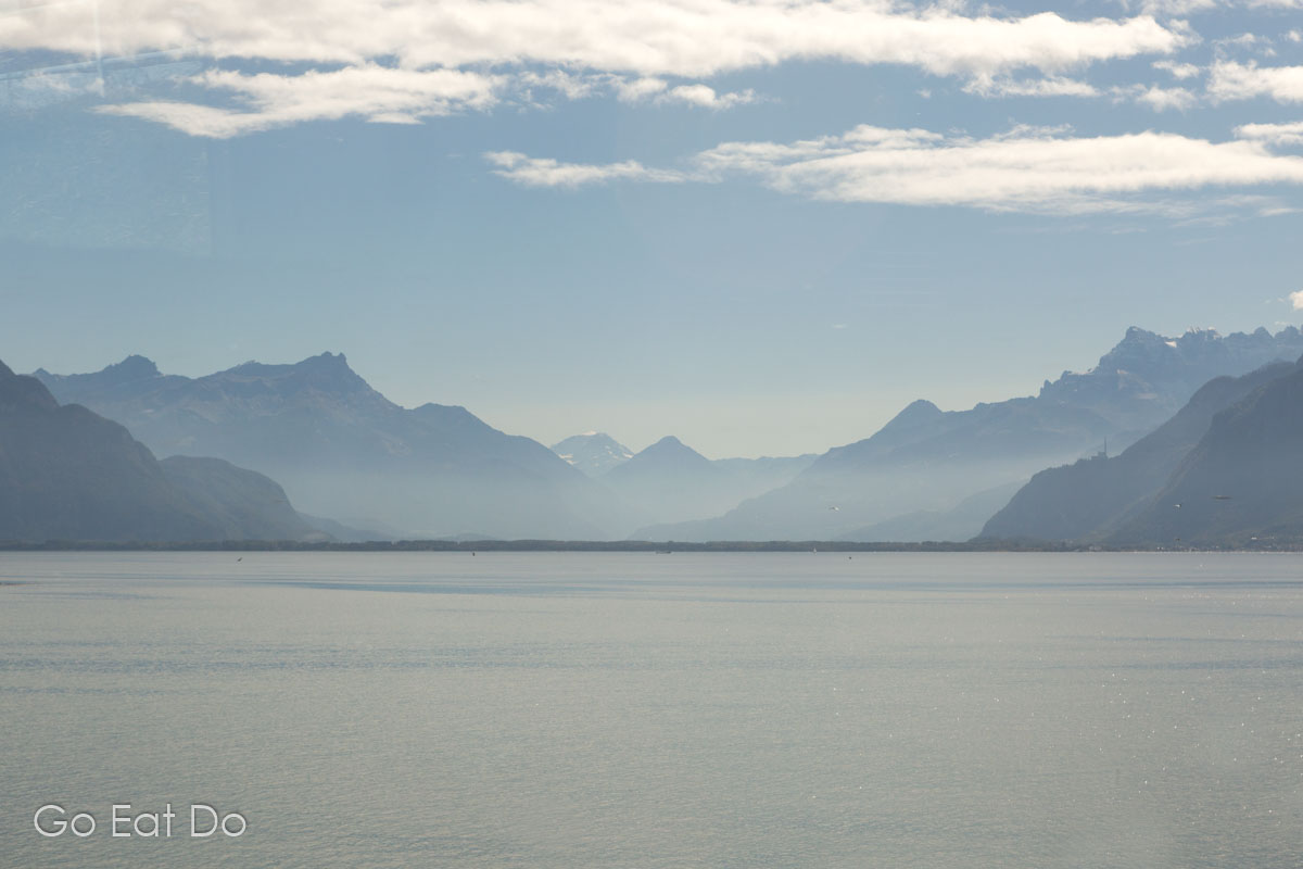 Lake Geneva seen from the window of a Swiss train travelling around the lake in Switzerland.