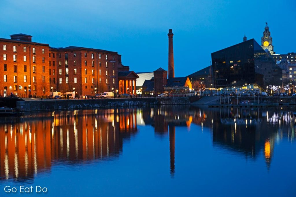 Buildings of the Royal Albert Dock reflect in Liverpool's Salthouse Dock.