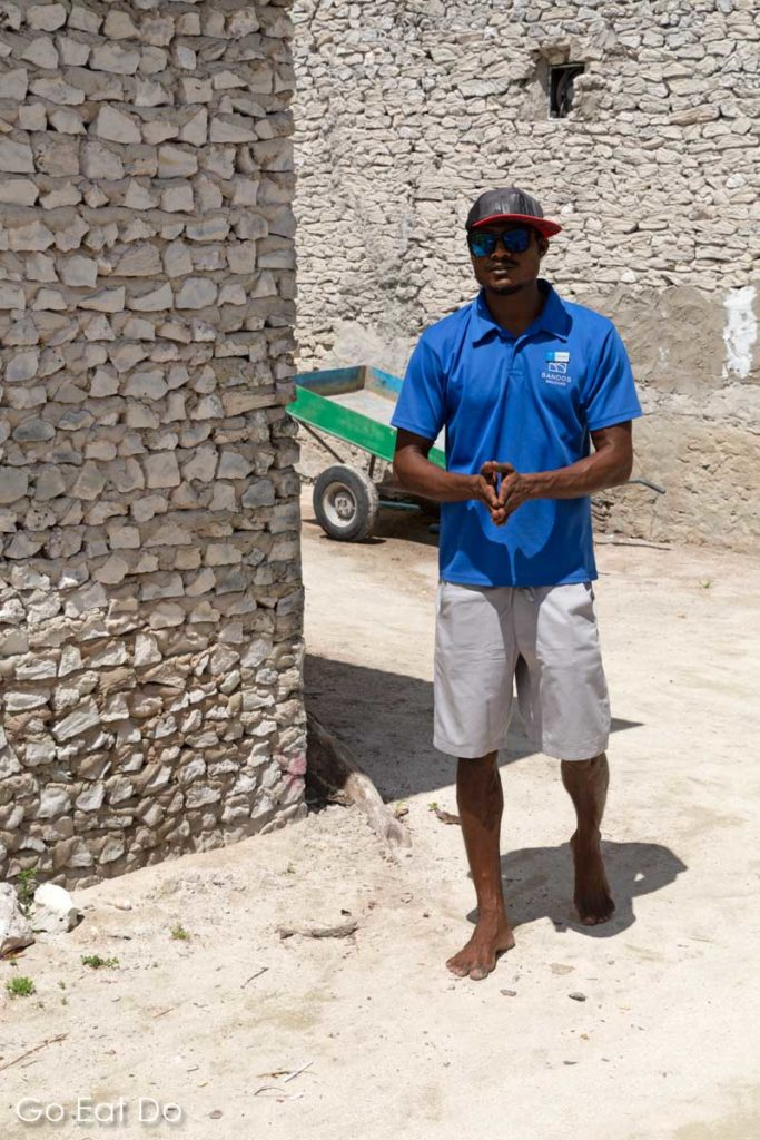 Tour guide discussing traditional construction methods on Huraa Island, one of the Maldlives' local islands.