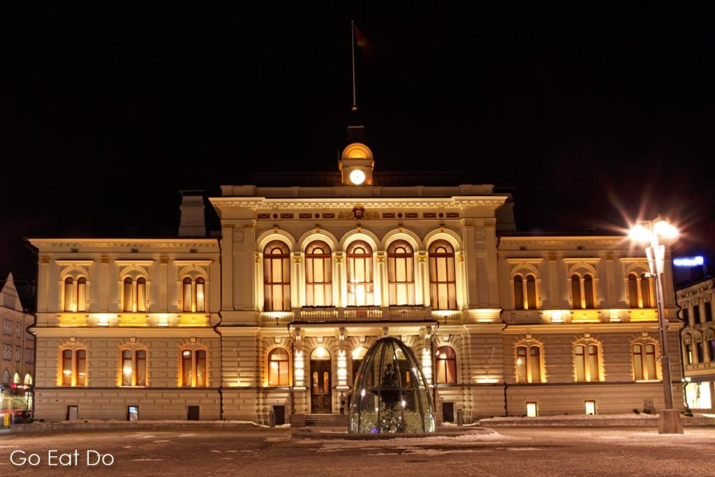 Tampere Town Hall (Raatihuone), a neo-renaissance style building designed by Georg Schreck and built 1890, stands on the city's central square and is seen here illuminated at night.